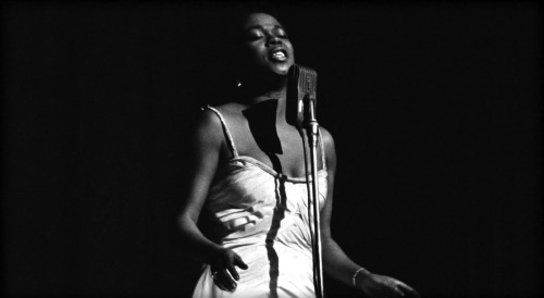 Kevin Whitehead reviews Sarah Vaughan, Divine: The Jazz Albums, 1954-1958:  A lot of jazz singing is about consonants—the percussive attacks the music swings from. With Sarah Vaughan, it's also about the way she rolls out her vowels, reveling in a held note like Miles Davis. Later her vibrato could get excessive, but in the mid-'50s her taste and control were a marvel. That much is clear from a new anthology of Vaughan on EmArcy, Divine: The Jazz Albums 1954-1958 (Verve Select). (In that period she was made pop albums with strings, and some of the same tunes.) It's six albums-plus on four CDs, recorded live or in the studio, with bands big and small. All but one session is sparked by another bebop institution, drummer Roy Haynes. He has a springy beat, using brushes, and doesn't overplay.  Sarah Vaughan had a gallery of vocal timbres, gravelly to silky, round or strident, white-gloved or blues-drenched. Her pitch range was operatic, and her low notes have uncommon power. She drew inspiration from great soloists and gave it right back   Image via vainsmith