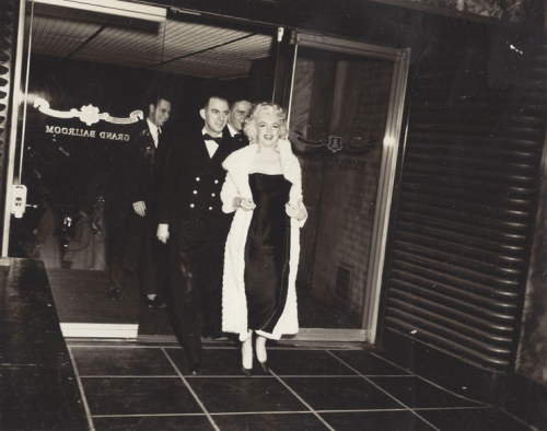 Marilyn Monroe with sailors at the USS Bennington Ship's Dance at the Astor Hotel Ballroom in New York's Times Square, March 31, 1955.