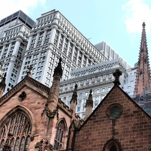 NYC Series: Trinity Church. Richard Upjohn. 1864. (3rd Building) Wall Street & Broadway. Neo-Gothic. Background: Equitable Building. Graham, Anderson, Probst & White. 1915. Neo-Classicism. Its construction resulted in the NYC Zoning Law of 1916.