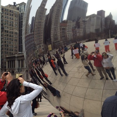 "A remarkable scene today at  ""Cloud Gate"": this couple snaps the obligatory shot in reflection as a number of Guantanamo Bay Prison protesters show up. They didn't notice they had been photobombed until after the protesters were ordered to move on by a Chicago park ranger. #art #contemporaryart #protest #photobomb  (at Cloud Gate)"