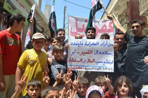 "A message from the town of Kafranbel to all revolutionaries: ""Whoever wants his dignity should take his weapons to Al-Qusayr, and cut his love for money and authority"" Thanks @NMSyria"