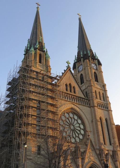 Scaffolding surrounds the east steeple of Gesu Church on the Marquette University campus.
