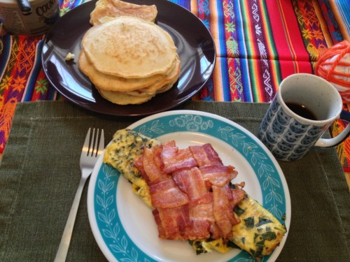 Dinah Party's Green Kale eggs and Ham bacon lattice stuffed with quinoa, sweet potatoes, tomato, and onion. Coffee. Water. Manpanion's stack o' pancakes.