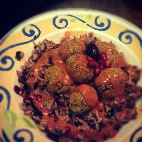 Falafel over wild rice with sundried tomato, olive & pom in kimchi citrus sauce #dinner #homemade