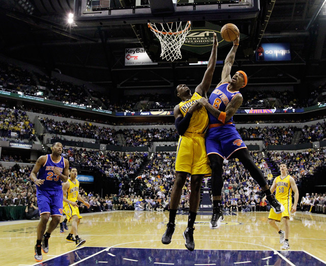 Knicks guard J.R. Smith dunks over Pacers center Ian Mahinmi during Thursday's game in Indianapolis. New York, playing without a suspended Carmelo Anthony, fell to Indiana 81-76. The Pacers have won 12 of 15 and swept the two other Eastern Conference division leaders this week. (AP Photo/Darron Cummings) THOMSEN: Go around the NBA in this week's Sixth Man
