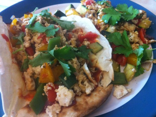 Tofu scramble wraps with bell pepper, courgette, tomato and coriander and lots of sriracha (Home meal)
