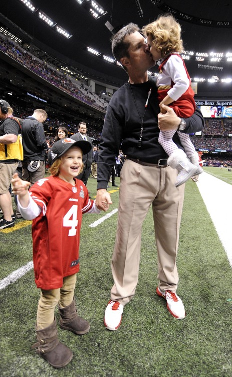 San Francisco 49ers head coach Jim Harbaugh greets daughters Addison and Katherine before Super Bowl XLVII against the Baltimore Ravens at the Mercedes-Benz Superdome. (Photo by Robert Deutsch, USA TODAY)