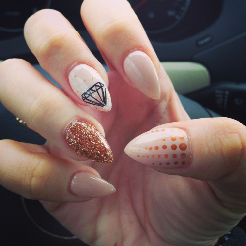 I like the glitter, the diamond, and the talon-shape. c: