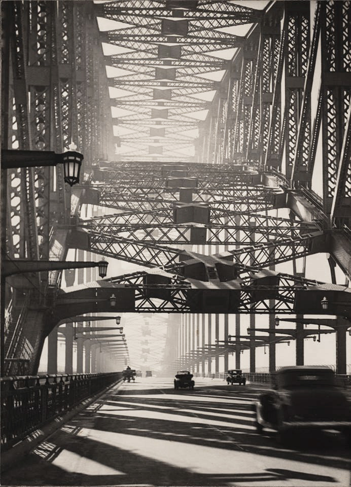 """© Harold Cazneaux, around 1934, 'Sydney Bridge', Australia """"To get on in Australia, you must make two observations. Say, 'You have the most beautiful bridge in the world' and 'They tell me you trounced England again in the cricket.' The first statement will be a lie. Sydney Bridge is big, utilitarian and the symbol of Australia, like the Statue of Liberty or the Eiffel Tower. But it is very ugly. No Australian will admit this."""" (James Michener in 'Return to Paradise')"""