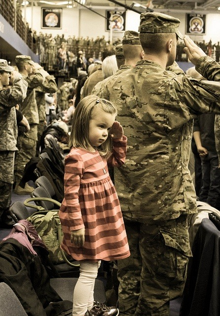 loveofatravelingsoldier:  Daniella, salutes behind her father, Capt. Dan Moen of 1-89 CAV, 2nd BDE, 10th Mountain Division, during the National Anthem at his deployment ceremony on January 11, 2013, at Fort Drum, NY. Photo by Sasha Moen