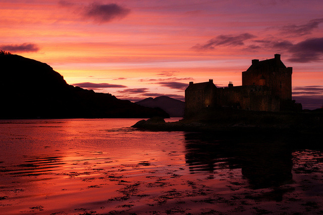 neptunesbounty:  Eilean Donan Castle Sunset, Scotland by flatworldsedge on Flickr.