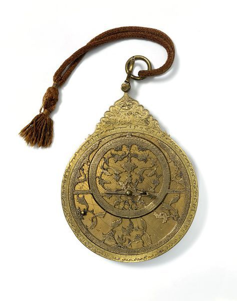 purplefigtree:  Astrolabe Isfahan, Iran, 1667. Brass, pierced and engraved. Signed as made by Khalil (Muhammad) son of Husayn 'Ali, and decorated by Muhammad Mahdi son of Amin of Yazd.