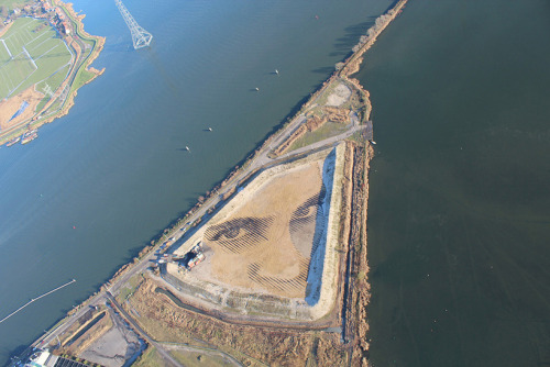 "This awesome portrait, a work of aerial land artwork in Amsterdam measuring the length of two football fields, was created by Cuban-American contemporary artist Jorge Rodriguez-Gerada and completed thanks to the help of 80 volunteers. Commissioned by a feminist organization called Mama Cash for their campaign, ""Vogelvrije Vrouwen - Defend women who defend human rights,"" the work ""depicts the portrait of an anonymous Mesoamerican woman in honor of female activists and as a protest against their persecution in the Mesoamerican region."" Check out a 360 virtual tour of the artwork here. Visit Designboom to view photos of the construction process."