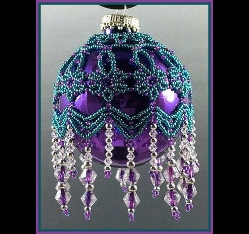 Hand-crafted teal and purple beaded ornament.