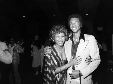Minnie Riperton and tennis legend Arthur Ashe at the Arthur Ashe Roast at the Beverly Hilton Hotel in 1976. Photo by EBONY photographer Isaac Sutton.