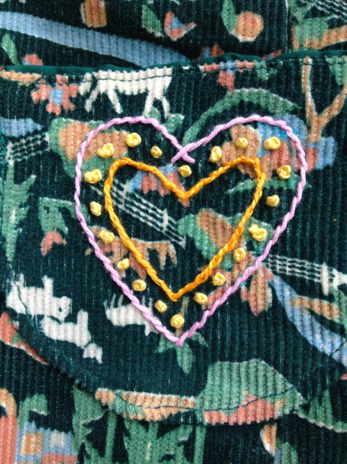 learning some embroidery by stitching a heart on the pocket of my favorite vest