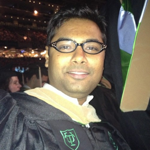 Prassanth's graduation wish was to try on my glasses.  (at Tulane Graduation 2013 at The Superdome)