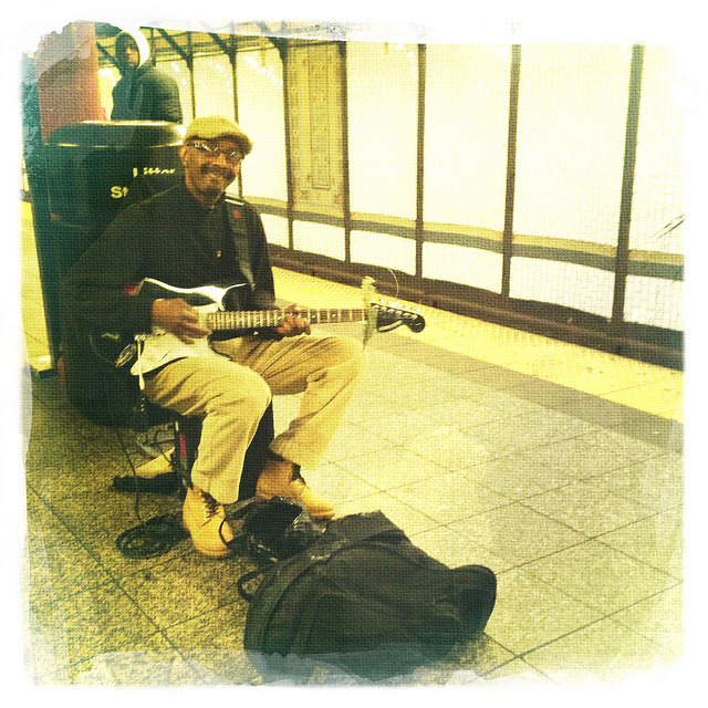 playing guitar at 72nd street. on Flickr.Subway musician playing guitar at the 72nd Street station.