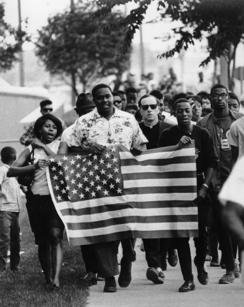 "wiscohisto:  Fair housing march, Wauwatosa, Wisconsin, 1966 (James Groppi, center). We're recapping the top 12 most-liked and most-reblogged photos we posted in 2012. #11 was one of the dramatic images of Civil Rights activists selected by guest curator Mark Speltz, who provided an overview of Milwaukee's Civil Rights movement for us in January 2012.   When we posted this photo last January, a reader asked if we could identify the other people marching with Groppi. Activist Margaret Rozga (wife of Father Groppi) identified several: ""Unfortunately most of the people on the picture have died. The woman on the left is Carol Butler, the tallest person is Duane Tolliver. The person in the sunglasses behind Carol Butler may be Forthune Humphrey. The woman behind the two Youth Council men on the right (with her right hand up at her forehead) is Vada Harris."" In 2007, Rozga published an article about the ""March on Milwaukee"" in the Wisconsin Magazine of History. via: Wisconsin Historical Images WHi-25167 by way of March on Milwaukee Civil Rights History Project, UW-Milwaukee Libraries"