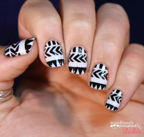 wondrouslypolished:  Black and white geometric tribal for Mani Monday!