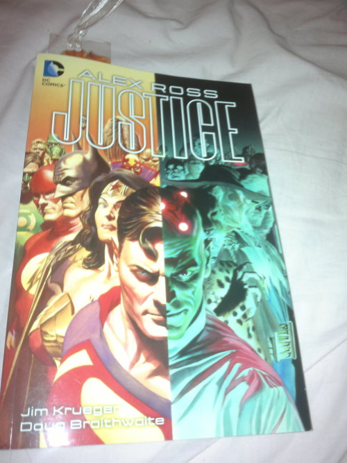 I'm currently working my way through the eye-popping amazingness of Justice by Alex Ross (Written by Jim Krueger and Pencil art by Doug Braithwaite and . So much amazing artwork and plots too handle right now! Definitely the best graphic novel I have ever read!