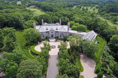 Brookline, MA's spectacular Woodland Manor was just reduced by $26M! It was previously on the market for $90M and can now be yours for $69M. Designed by Shope Reno Wharton.