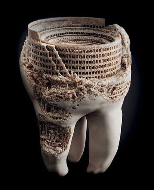 ryanandthecrew:  The Roman Colosseum carved into a human tooth.