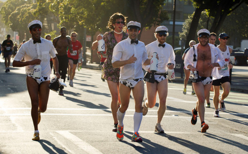 A group of men dressed as milkmen jog along Fell Street during the 102nd running of the Bay to Breakers 12K in San Francisco, Sunday, May 19, 2013. More than 30,000 runners — from the elite to the weekend warrior — made the 7.62-mile trek from Howard and Spear to the Great Highway. (D. Ross Cameron/Bay Area News Group)  I wonder if these guys would have been allowed at AT&T Park last year with all the Melkmen craze? Only in SF right?