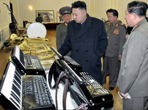 kim jung un looking at musical instruments