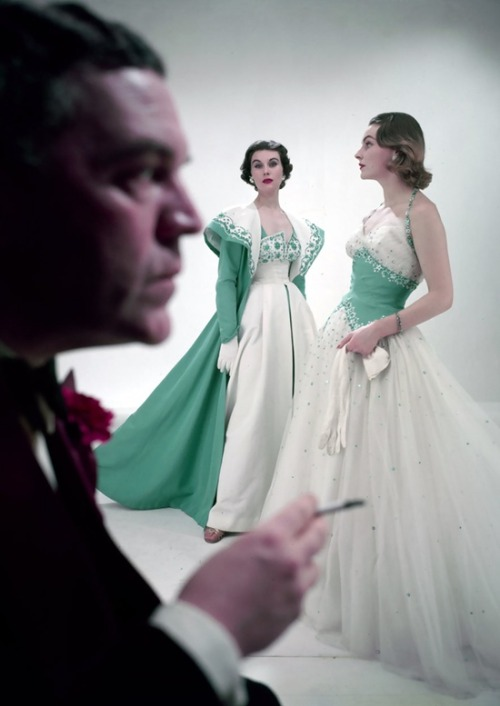 theniftyfifties:  Norman Hartnell with models wearing his designs, 1953. Photo by Norman Parkinson.