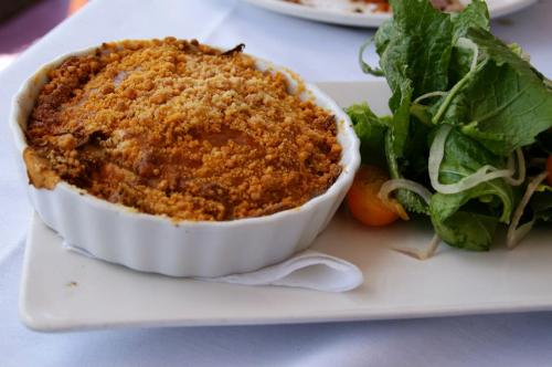 Mirliton, smoked cotija gratin with crispy masa crumble, preserved kumquat and mustard green salad from Boucherie *Submitted by Betina Piqueras