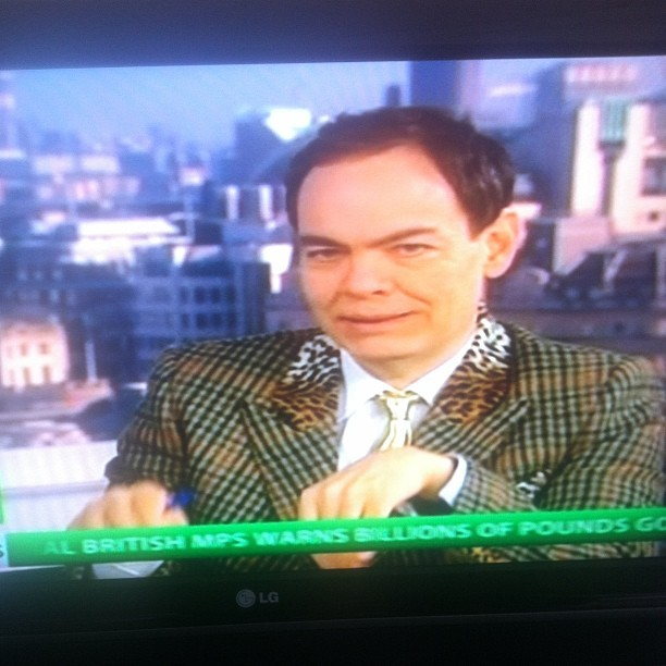 News camera ready with a gold tie and leopard print collar. 👔