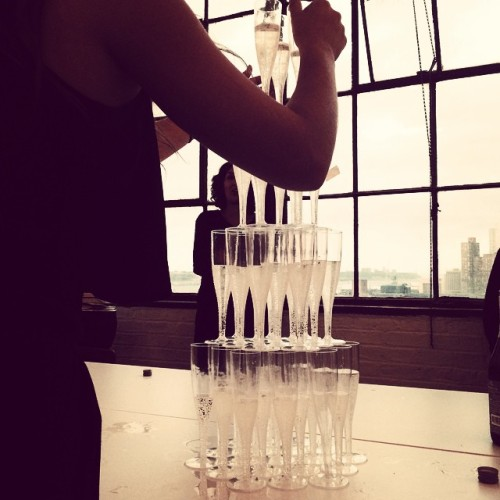 @li_na_bo's dream :) a champagne pyramid 👏 (at Bjarke Ingles Group)