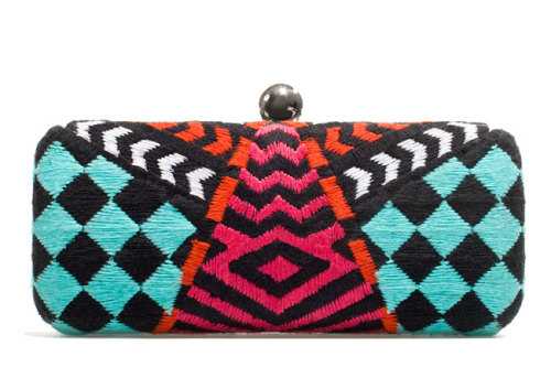 Store your gloss and cell in a clutch featuring a graphic pattern and bold hues! Check out more cool clutches » Zara Clutch, $50. Zara.com.