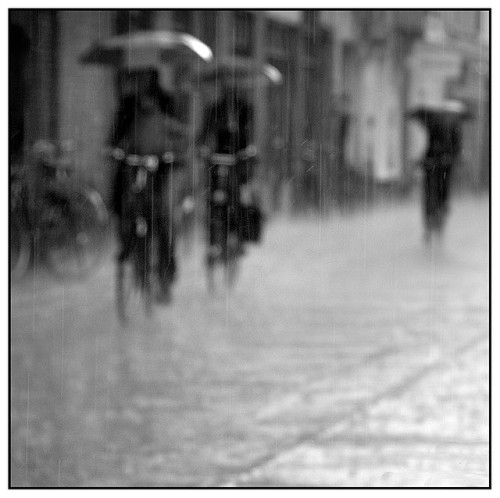 Cycling through the rain by PhotoA.nl