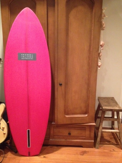 Conner Coffins hand shaped pink single fin. Via youngwisetails