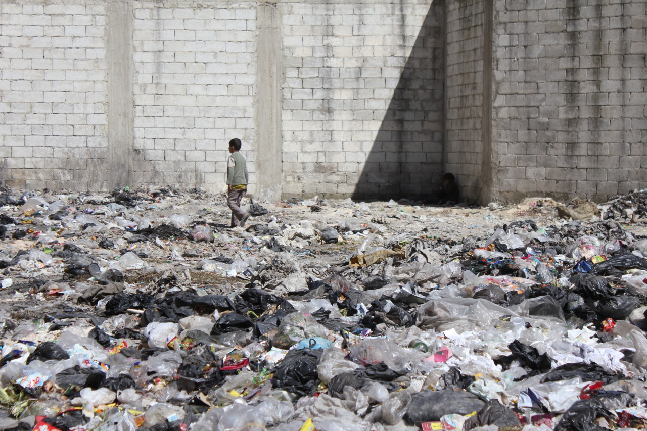 March 15th - A boy walks across one of the many waste-fields in reef (suburb) Aleppo. A week later, the Aleppo Civilian Council began an initiative to clean up  the city's streets.