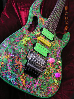 guitar-porn:  Custom Jem with green vine neck and hand painted body. Thanks to Al K for sending in this 'none more psychedelic' piece of Ibanez art.