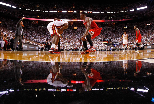 LeBron James is guarded by Jimmy Butler during Game 5 of the Eastern Conference Semifinals between Miami and Chicago on Wednesday. James recorded 23 points in a 94-91 series-clinching victory for the Heat. (Mike Ehrmann/Getty Images)  GALLERY: Rare Photos of LeBron James