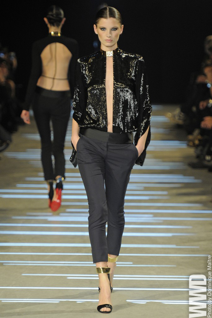 womensweardaily:  Alexandre Vauthier Spring Couture 2013  The show opened with an elegant and tasteful lineup of clean-cut tuxedos and lightly draped satin catsuits, which had sleek glamour written all over them.  For More  Sleek