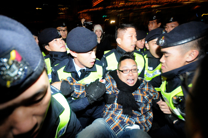 HONG KONG (01/01/13) — A protestor is arrested by police during a protest against the city's leader Leung Chung-ying in Hong Kong on January 1, 2013. Tens of thousands of protesters took to the streets of Hong Kong on January 1, calling for the city's embattled leader to quit and demanding greater democracy 15 years after it returned to Chinese rule. Photo by Justin Chin
