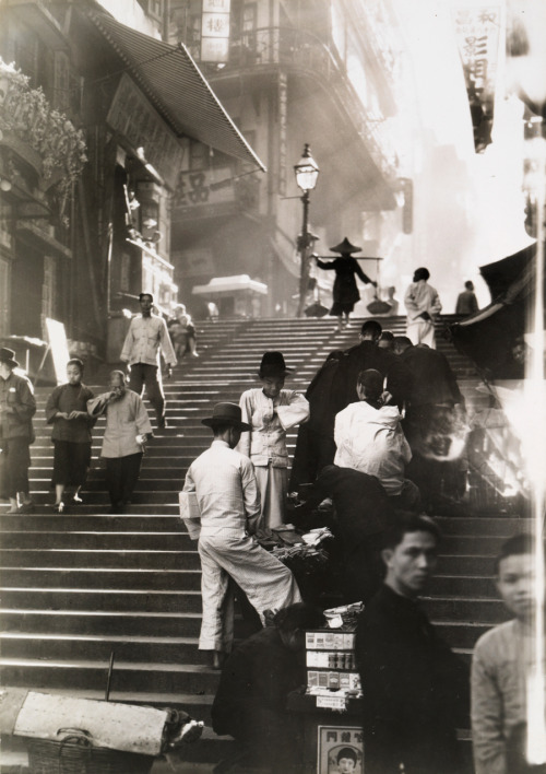 jhilla:  natgeofound:  Vendors and pedestrians along a steep staircase in Hong Kong, November 1934.Photograph by W. Robert Moore, National Geographic  There's so much about this picture that makes it incredible.  Compositionally, the focus and clarity drew me to the scene of the two boys in white.  But then the lighting and vantage point led my eyes up to the woman carrying the packages on her shoulder.  From there the light hit and the rays brought me all the way back down to the front of the picture again.  I literally stared at this for, like, 15 minutes. But even with all of that, I think my favorite part is the over exposure in the far right of the picture.  It almost looks like something from another frame may have leaked in.  And it gives the feeling that even though this picture seems so perfect, it was probably still taken in an instant. Deep thoughts by Jeff Hilliard