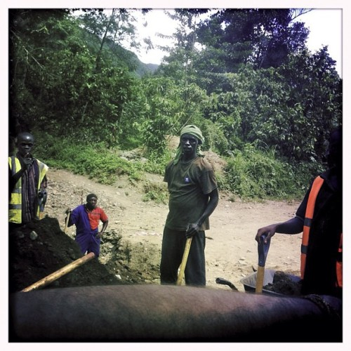 Construction workers building a new road between Fort Portal and Bundibugyo, Uganda on May 31st, 2012. Photo by Peter DiCampo @pdicampo #uganda #fortportal #bundibugyo #construction #labor #work #development #africa #transportation