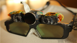 "From Gizmodo: ""Ex-Valve Engineers' Crazy AR Glasses Put Tiny Projectors On Your Face."" Basically, once you don the glasses, the projectors shoot images out at a specialized, reflective projector screen. Then the screen spits them back at your face, and the glasses split them into left-eye and right-eye images for your 3D viewing pleasure."