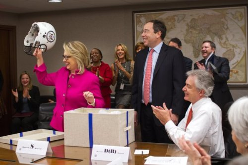 Back on the job, Clinton presented with football helmet after concussion (Photo: State Department) Secretary of State Hillary Clinton got a standing ovation at her first day back at work since suffering a concussion and blood clot. She was presented with a gift from her staff: protective head gear — a football helmet with the State Department logo on the side. Read the complete story.