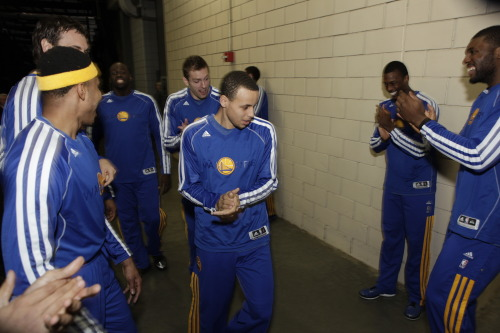 nba:  Stephen Curry of the Golden State Warriors is pumped up by teammates before the game between the Golden State Warriors and the Portland Trail Blazers on April 17, 2013 at the Rose Garden Arena in Portland, Oregon. (Photo by Sam Forencich/NBAE via Getty Images)