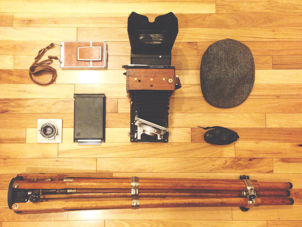japancamerahunter:  In your bag No: 434 - Joel Chavez  Dream camera bag. That tripod is beautiful. I'd rather sheet film than polaroid though.