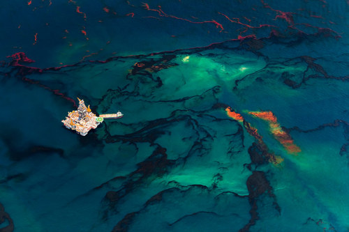 guardian:  Aerial view of oil leaking from the Deepwater Horizon wellhead in the Gulf of Mexico. This images is part of an exhibition at Somerset House in London, of 130 original photographic works taken around the world, from Mitch Epstein's image of an American oil refinery to Nadav Kander's smog-filled vision of the Yangtze river in China. Photograph: Daniel Beltra