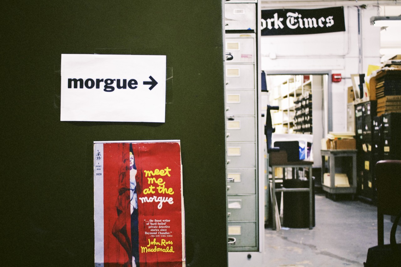"The Morgue Is Alive! Inside the New York Times Photo Archive, Where History Lives On  This story was written and produced in partnership with WNYC. It is a cramped basement annex, stacked high with metal filing cabinets, full of three-fourths of a million pounds of old newspaper clippings and photos, going back 160 years. It's simply called ""the morgue."" To get here, a reporter must leave the shiny glass tower that is the 40th Street headquarters of the New York Times, walk a half-block down the street, and descend three levels below the sidewalk. There, in a nondescript tower, she will emerge from a dirty elevator, walk past a janitor's closet, then a giant, rusted pump with running water, and finally reach a pair of metal doors. There are glue traps with belly-up cockroaches in the corner. ""I swear, we haven't taken you to a torture chamber,"" jokes Times photo editor Darcy Eveleigh, as she leads me through the double doors. There is no computer in the morgue. No internet service or cell reception. If we were to die here in the morgue — perhaps by an improperly secured two-ton cabinet — it's safe to say it would take days for anyone to find our bodies. Welcome to the archives repository of the most respected newspaper in the world.   Where History Lives On The morgue's keeper is a tall, dapper man named Jeffrey Roth, who greets us in a necktie, brown plaid suit jacket, and slacks. He is impeccably dressed for our surroundings. Over the next four hours, he will lay out the intricacies of how the morgue once worked, and how it still works today: Clippings and photos are filed into neatly organized manila folders, organized by subject and biography, then recorded — first by hand, then by typewriter, then no longer recorded at all — onto index cards. At the morgue's height, there were as many as two dozen clippers, filers, indexers, and counter-clerks, sifting through 16 copies of the paper each day, so that when a reporter needed background research, he had a place to go. The morgue wasn't always housed in a tomb, of course — though it's said to have gotten its name because it was the place where dead stories were kept. But long before the days of Google, newspaper morgues were considered the heart of any newsroom — a place where history was chronicled, clip by clip, photo by photo. It was here, in the morgue, that on the night of April 15, 1912, two morgue-keepers helped the Times scoop the world in its coverage of the Titanic, digging up hundreds of biographical histories, construction data, and disaster records that no other paper had bothered to save. It was the morgue that housed the original print of Lyndon Johnson being sworn in as president, for the first time, with Jackie Kennedy by his side in a blood-stained suit. And it was through the morgue that figures like Jack Dempsey, Charles Lindbergh, and Marilyn Monroe would pass, the Times publisher himself offering up their biographical folders to sift through. ""As all newspaper men know,"" the Times wrote in 1970, in an obituary of one of its morgue keepers, ""the morgue is anything but a dull place."" And yet, over the years, as the newsroom has gone digital, as the staff of the morgue has shrunk from 20 to 1, and as the morgue itself has moved deeper and deeper below ground level, the space has slowly but surely been forgotten among the shiny new computers, budget-crunching, and fancy new digs upstairs. ""Out of sight, out of mind,"" as Roth puts it. Many of the young Times reporters don't even know it exists, despite working above it each day. To put the rarity of the Times morgue in perspective: the Daily News, ""New York's Picture Newspaper,"" downsized much of its archive around the time it moved into its new office, in the mid-1990s. Time magazine's fabled library was sent to New Jersey a decade ago, and Newsweek's research library was mostly donated to the University of Texas — though not before dozens of boxes were accidentally carried off to the dump. ""I think we can agree that the first responsibility of [a newspaper] is not to its picture morgue but to today's news, and it is no secret that the old structures of newsgathering are under stress,"" says Peter Galassi, the longtime curator of the MoMA, which keeps a number of Times photos in its permanent collection. ""The more attention and resources we devote to the past, the less remains for the present."" The Times morgue has managed to survive, yet it is constantly fighting for its life as media organizations must face the implicit question: Do physical archives even make sense in the digital age? ""It's a perennial tension, and it goes back decades,"" said David Dunlap, a longtime metro reporter who is the Times' unofficial historian. ""The morgue takes up a lot of physical space, and in Midtown Manhattan, physical space costs a lot."" The Times stopped clipping articles in 1990, and since then, 30,000 books, dozens of filing cabinets, and hundreds of boxes have been donated or tossed, says Roth. Today's morgue holds about 500 cabinets (he's counted), housed in a space the size of a large-ish one-bedroom apartment. The Keeper of the Morgue The man who's kept the morgue in business for the past two decades — though he'd never, ever speak so highly of himself — is 53-year-old Jeff Roth. His job has morphed from counter-clerk (back when the morgue actually had a counter) to a one-man-show that now includes electronic indexing, sweeping the floors, and hammering out the locks when a cabinet gets jammed. Roth didn't have a traditional reporting background. He joined the morgue in 1993, after visiting the space to research his distant cousin, Times reporting great Meyer Berger. He says he's worked as a stockbroker, landscaper, art dealer, cross-country truck driver, and a narcotics search agent at JFK — a skill that came in handy for the Times when TWA Flight 800 went down (he knew the onboarding and offboarding procedures). Ask Roth about almost anything — New York City explosions, feminist history, Yeats, Iran — and he will know the answer. It's as if the wisdom of the morgue has filtered into his blood. Over the years, Roth has stumbled upon a long-lost engagement photo of Diane Arbus, and the first-ever published photo by the late photographer W. Eugene Smith, known for his vivid images during WWII. (The photograph, of a latrine, was taken when Smith was 16; his parents' Witchita, Ks., address is hand-written on the back.) A few years ago, Roth discovered a set of unseen photos of Jimi Hendrix at Woodstock (mislabeled as ""Hendricks"") and an unpublished contact sheet of the Stonewall Riots — the only known images of the uprising's finale that had been lost inside a folder labeled ""NYPD Tactical Unit."" ""There are things in here that are nowhere else,"" Roth says, using the favorite word of morgue-keepers throughout the years — ""serendipity"" — to describe the morgue's allure. Still, Roth doesn't like to make a big deal out of any of these tiny miracles — except when he's fighting for the life of the place that invokes death in its name. In 2007, when the morgue space shrunk by half, Roth drove into Manhattan every Sunday, from Long Island, and carted 5,000 books back to a storage space, where he housed them until he had the space to move them back. When the Times' business side asked him to show possible buyers the basement, in 2009, he wrote a scathing letter to one of the managing editors — and the morgue was suddenly moved back under the newsroom's control (and preserved, for now). Roth knows the morgue is of a different era. Its smell alone — dried newspaper ink, photo chemicals, linen paper — is one that many-a-blogger will never experience. And yet, with every search of the card catalog, it's as if an observer is stumbling back in time, thrust into a perfect preserved moment in history. Search ""Space"" — as in the space program — and you'll be redirected to ""Rockets."" Newspaper clips about ""Television"" can be found in the drawer labeled ""Radio."" And stories about ""African-Americans"" are still, somewhat jarringly, filed under ""Negroes."" (There was a big fight over that one, Roth notes, but in the end, there were simply ""too many folders to change."") It is a relic of an era past, and yet, Roth says, it is also a window into how we see the present — and one that, for all the benefits of online technology, simply couldn't be gleaned from a computer. Dunlap, who has worked at the Times for nearly four decades, remembers seeing the printed copy of the Times' first story on AIDS, in 1981, under the headline, ""RARE CANCER SEEN IN 41 HOMOSEXUALS."" It was a skinny column on the inside of the paper, eclipsed by a giant ad for the Independent Savings Bank. ""Gay"" hadn't yet been added to the Times style manual. And yet the placement of the story said it all. ""From a historical perspective, a collection like this is priceless,"" says Andie Tucher, a professor of journalism history at Columbia University.  New Life for an Era Past The morgue may conjure images of decay and death — dead stories, dead politicians, the death of, dare we say it, print — but to anyone who's had the luck of spending any time there, its value is clear: a place of living, breathing history that remains largely untouched by time. Saving graces work in mysterious ways, of course, and today, the morgue may be resurrected by the same force that for so long threatened to kill it. Since September 2010, the Lens blog at the Times has featured an occasional series of archival photos, dug up from the morgue by Times photo editor Eveleigh. From black-and-white images of Antarctica to the art of window-washing, getting the photos print-ready took some work. The images had to be repaired for tears and cracks, retouched and scanned, markings erased, sometimes whited-out limbs put back in. But after just a few entries, the series became so popular that it led to a knockoff site. Readers began sending in their own photos. And suddenly, the word ""morgue"" — long forgotten around the newsroom — was back in vogue. Lexi Mainland, the Times' 33-year-old social media editor, heard about the project, and proposed a Tumblr where the photos could have a permanent home. Six months later, the Lively Morgue blog was born, with new entries every week. There was a warehouse full of mannequins, a moose blimp over Times Square, Nixon's reflection over a dozen television screens, each shown with the backside of the photo, complete with the photographer's notes, the price paid for the print, and — if it wxas published — a clipping of the original caption. If the Lively Morgue were to post 10 new archival images every week, it would take until the year 3935 to post every image housed in that vault. ""I think the value of the morgue is akin to the value of the historic record of Times journalism in general — to my mind, priceless,"" says Mainland. ""As we get more and more rooted in the world of pixels, I think it's critical that we find ways to bring important collections of information with us as we go."" She adds, ""If only Tumblrs could have a smell."" They can't, of course. But for now, at least, the morgue is very much alive. —Jessica Bennett, formerly of Newsweek, is the executive editor of Tumblr."