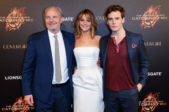 Francis Lawrence, Jennifer Lawrence & Sam Claflin attend The Hunger Games: Catching Fire Party during the 66th Annual Cannes Film Festival at Baoli Beach in Cannes, France. [May 18th, 2013]